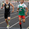 Lapel's Kyle Nardi, left, and Anderson's Bryant Thomas battle for second in the final leg of the 4x800-meter relay during the Madison County Track and Field Championships at Madison-Grant on Friday. Pendleton Heights finished first followed by Anderson in second and Lapel in third.