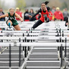 Anderson's Kalyn Davis wins the 100-meter hurdles during the Madison County Track and Field Championships at Madison-Grant on Friday.