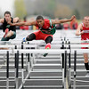 Anderson's Derrick Dabney wins the 110-meter hurdles at the Madison County Track and Field Championships at Madison-Grant on Friday.
