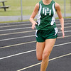 Pendleton Heights' Chelsea Blackwell leads the 1600-meter run during the Madison County Track and Field Championships at Madison-Grant on Friday.