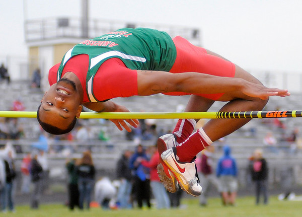 Anderson's Ty Agnew clears 5 feet 10 inches in high jump competition during the County Championship Track Meet at Madison-Grant on Friday.