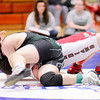 Don Knight | The Herald Bulletin<br /> Pendleton Heights Spencer McCool wrestles Anderson's Nick Brown in the 182 pound championship during the County wrestling tournament at Elwood on Saturday.
