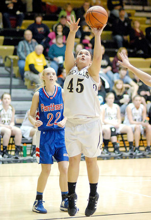 Kaycie Pyle lays the ball in for Madison Grant.
