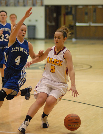 Courtney Skinner brings the ball downcourt for the Alexandria Lady Tigers.