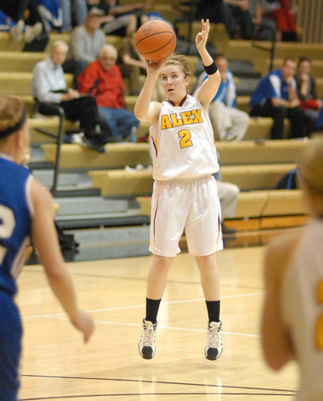 Shanna Kelly takes a three point shot for the Lady Tigers.
