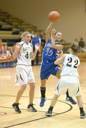 Elwood Lady Panther Jessie Noone passes the ball to a teammate.