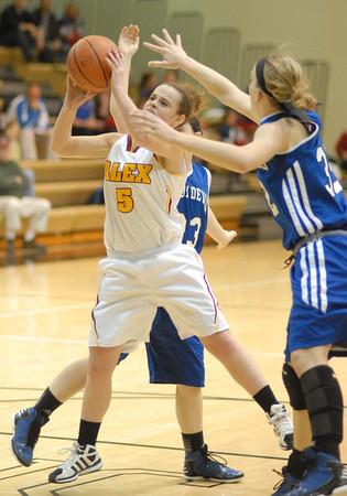 Alexandria Lady Tiger Courtney Skinner battles for a rebound.