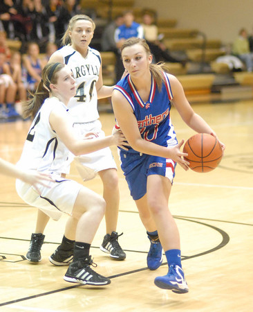 Taylor Noone drives out of the foul lane for the Elwood Lady Panthers.