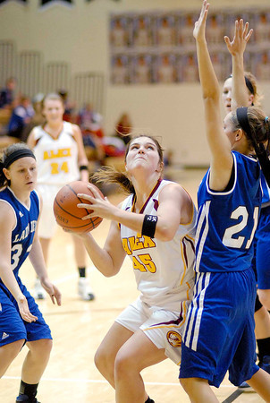 Desirae Litchfield drives through the foul lane during the Lady Tigers Sectional game against Tipton High School.