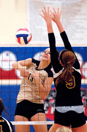Madison-Grant's Hunter Wise spikes the ball against Alexandria's Allie Hueston.
