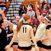 The Madison-Grant Lady Argylls celebrate their Madison County volleyball championship win over Alexandria.