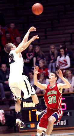 Photo by Chris Martin for THB/ Arabian's Kenton Dunham shoots a 3 over Anderson's Aaron Karr