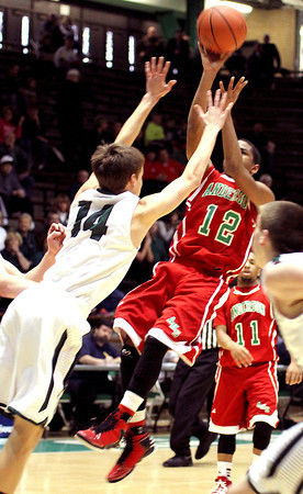 Pendleton's Levi Buck tries to block ZacAree Owens, of Anderson, shot during their 4A sectional game played at New Castle.