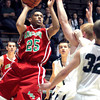 Photo by Chris Martin<br /> Anderson's Thomas Wells goes up for a baseline jumper against Pendleton's defenders.