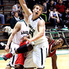 Pendleton's Nathan Phillips turns to the basket as Anderson's Kobe Clay looses his balance while driving the baseline.