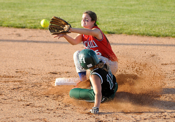 Pendleton Heights' Delilah Wright is tagged out by Roncalli's Allie Burkhardt as she tries to steal second during regional softball action on Tuesday.