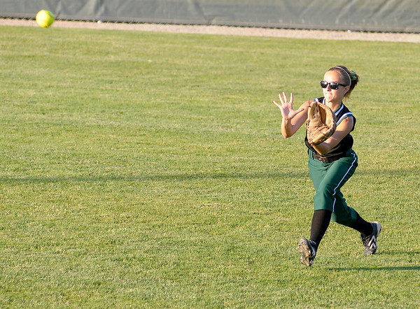 Pendleton Heights' Heather Wendling catches a fly ball in the outfield during regional softball action on Tuesday.