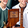 The Boys tennis sectional  championship hardware being held by Evan Hart and Graham McMullen.