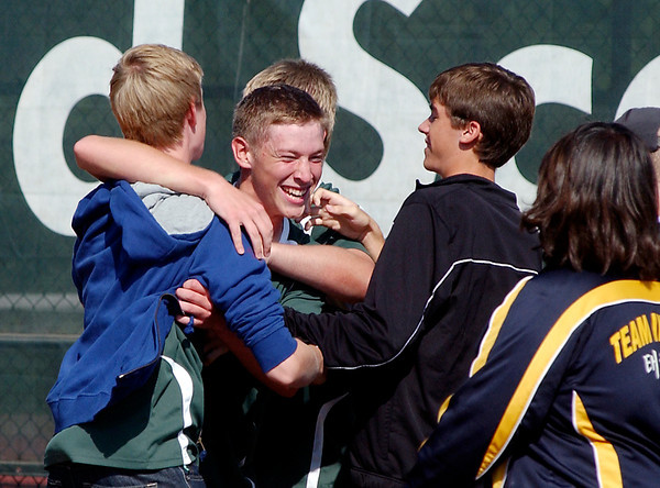 Pendleton Heights' Zach Howe celebrates the schools' first boys sectional tennis title with his teammates.