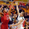 Pendleton Hts Kenton Dunham, right, gets his shot blocked by Pike's Zach Long as Dunham drove into the lane.