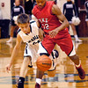 Pendleton's Levi Buck goes after the loose ball as Pike's Justin Thomas tries to cut him off to get to the ball first.