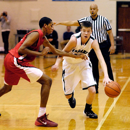 Pike's Tahjai Teague reaches in for the ball as Pendeton's Sean McDermott brings the ball up the court.