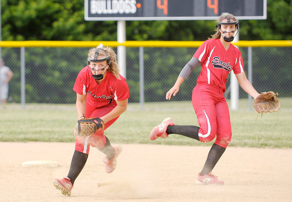 Don Knight   The Herald Bulletin<br /> Frankton's Ashtyn Rastetter fields the ball and looks to throw to first during the sectional championship at Lapel High School on Wednesday.
