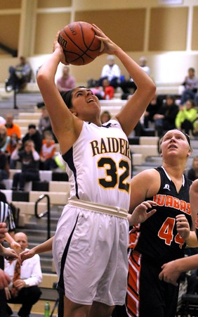 Chris Martin | for The Herald Bulletin<br /> Rachel Krathwohl goes for a layup for the Lady Raiders Saturday in a Regional loss against Wabash.