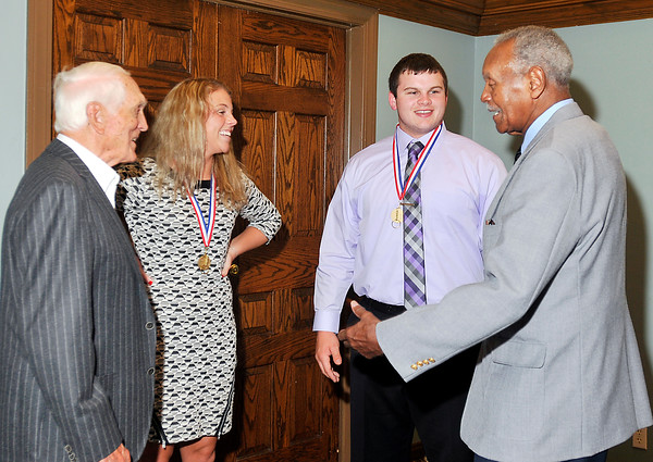 John P. Cleary   for The Herald Bulletin<br /> 2016 Johnny Wilson Award winners Taylor Noone of Elwood and Cody Rudy of Shenandoah talk with Carl Erskine, left, and Johnny Wilson, right, after the awards luncheon.
