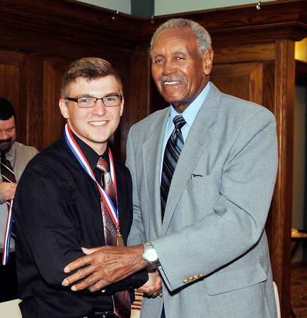 John P. Cleary | for The Herald Bulletin<br /> 2016 Johnny Wilson Award Nominee Bryce Montgomery of Alexandria HS with Johnny Wilson.