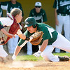 Pendleton Heights' Hunter Cook slides safely into home plate as catcher Braden Warren stretches for the ball as Alexandria defeated Pendleton Heights to win their first Muller title on Monday.