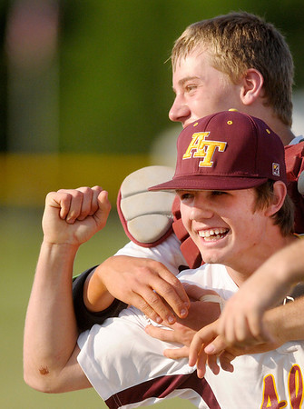 Drew Johnson, front, celebrates with catcher Braden Warren after Johnson caught a fly ball in the outfield for the final out in the top of the seventh as Alexandria defeated Pendleton Heights to win their first Muller title on Monday.