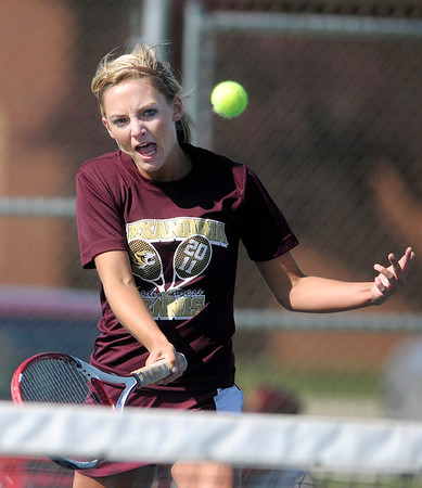 Alexandria's Michelle McFarren returns a volley to  Frankton's Alexys Rastetter <br /> at No. 1 singles.