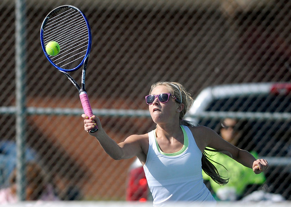 Frankton's Alexa Munger returns a volley to Alexandria's Abby Mathews in the <br />  No. 3 singles match.