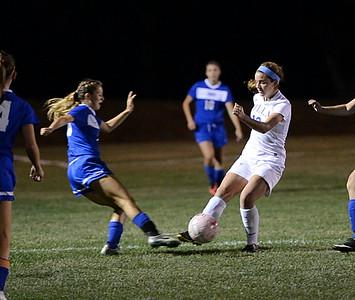 Villa Jo senior Kristen Glaum (R) gains control of the ball for the Jems.