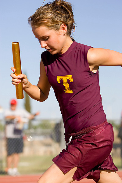 Second Leg of the girls 4 x 400 relay team for Tolleson High School competes in the high jump event during the 5a State Track and Field Championships at Glendale Community College on Thursday May 10th.