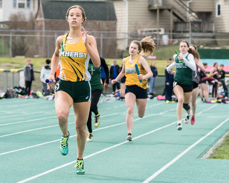 Amherst's Gracen Siegenthaler anchors the sprint medley to a third place finish at the 63rd Comet Relays Saturday April 21.  JOE COLON / CHRONICLE