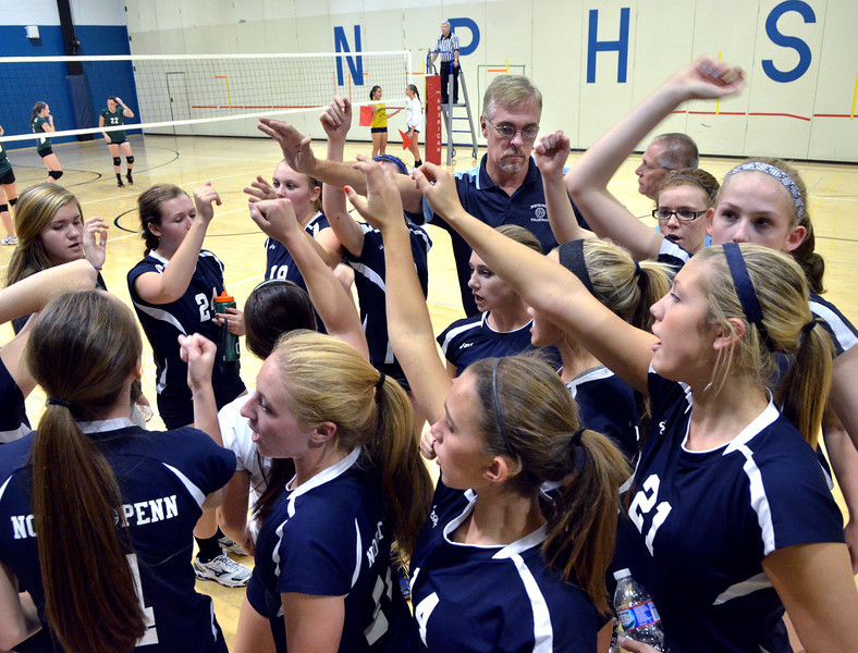 The North Penn Girls Volleyball Team rally together between games of their contest against Pennridge at North Penn High School on Wednesday September 25,2013. Photo by Mark C Psoras/The Reporter