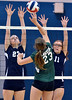 North Penn's  Devon Markus ,23, and Victoria Smith ,11, go up to block a shot by Pennridge's Madelyn Moser,23, during their contest at North Penn High School on Wednesday September 25,2013. Photo by Mark C Psoras/The Reporter