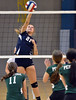 North Penn's Amy Pastuszak,21, spikes a shot past Pennridge defenders during their contest at North Penn High School on Wednesday September 25,2013. Photo by Mark C Psoras/The Reporter