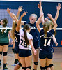 Members of the North Penn Girls Varsity Volleyball team celebrate after a point against Pennridge during their contest at North Penn High School on Wednesday September 25,2013. Photo by Mark C Psoras/The Repporter