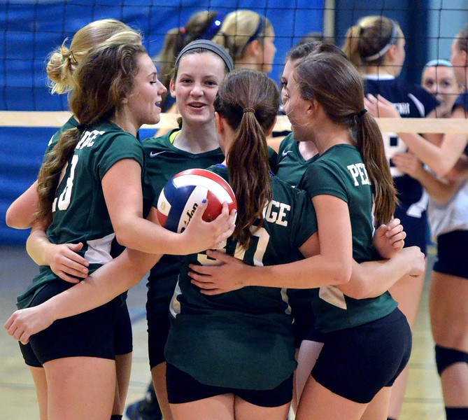 Members of the Pennridge Girls Volleyball team celebrate after a point against North Penn during their contest at North Penn High School on Wednesday September 25,2013. Photo by Mark C Psoras/The Reporter