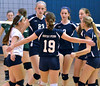 Members of the North Penn Girls Varsity Volleyball team celebrate after a point against Pennridge during their contest at North Penn High School on Wednesday September 25,2013. Photo by Mark C Psoras/The Reporter