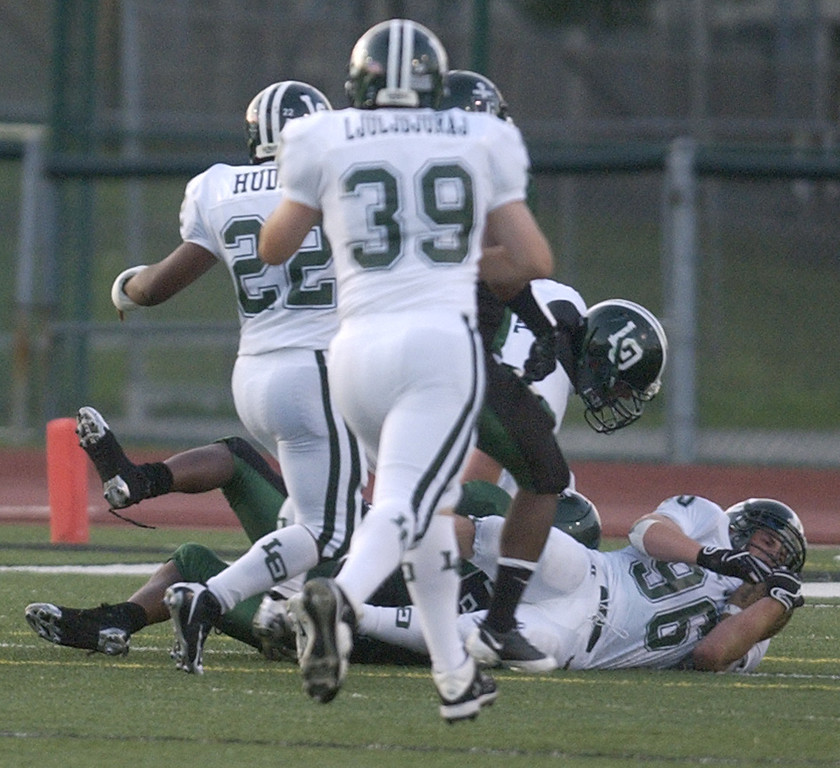 . Lake Orion High School football defensive player Philip Serzo, bottom recovers a fumble from West Bloomfield, during second quarter action, Thursday, September 3, 2009, in a game played at West Bloomfield HS in West Bloomfield, Mich.  (The Oakland Press/Jose Juarez)