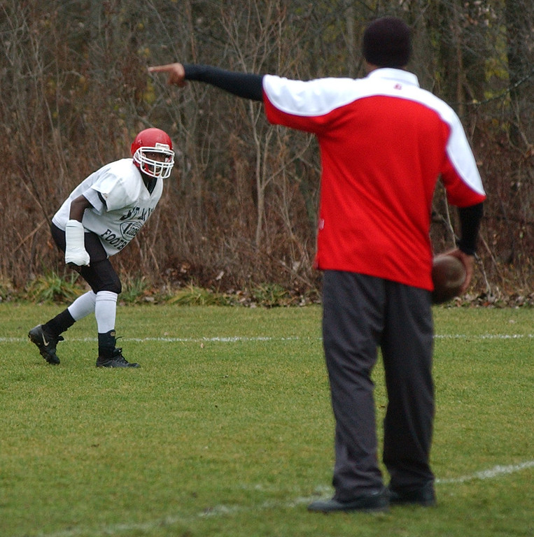. Orchard Lake St. Mary\'s High School football player Gary Hunter, background, prepares to defend a wide receiver during practice.  Photo taken on Wednesday, November 25, 2009, at OLSM HS in Orchard Lake, Mich.  (The Oakland Press/Jose Juarez)