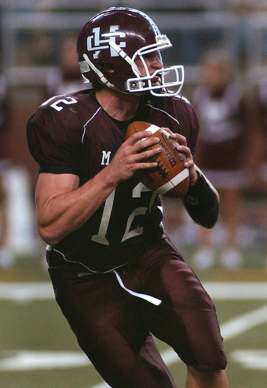 . Holland Christian High School football quarterback A.J. Westendorp drops back to pass against Birmingham Detroit Country Day during first quarter action, Friday, November 28, 2008, at Ford Field in Detroit, Mich.  (The Oakland Press/Jose Juarez)