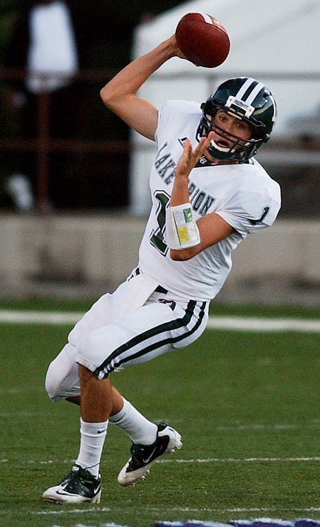. Lake Orion High School football quarterback Sean Charette drops back, fakes, and prepares to pass against Pontiac during second quarter action.  Photo taken on Friday, September 10, 2010, in a game played at Wisner Stadium in Pontiac, Mich.  (The Oakland Press/Jose Juarez)