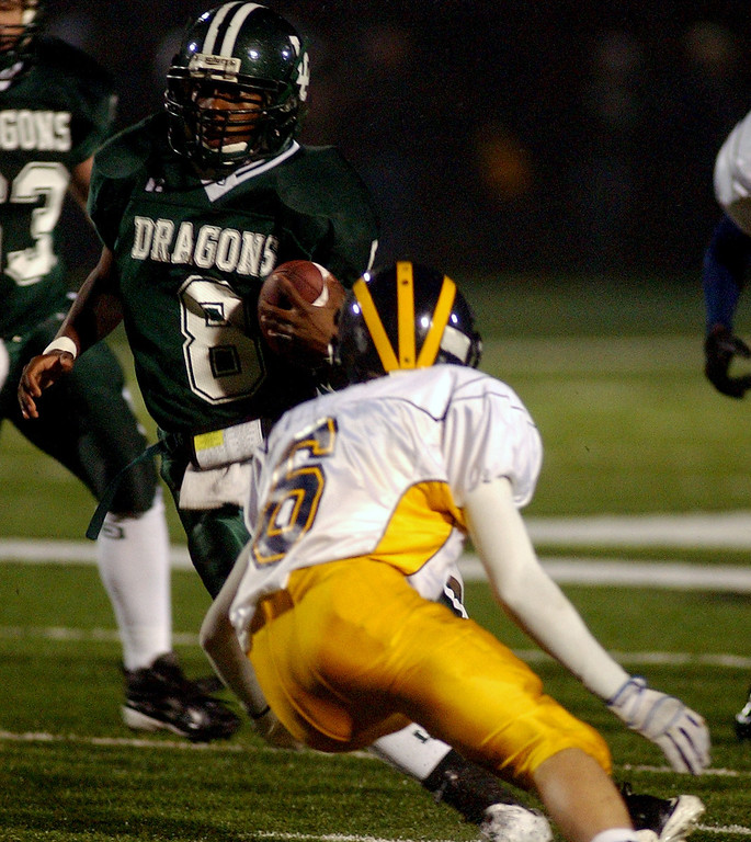 . Lake Orion High School football player Mikael Lott, left, runs for yardage as he is about to be tackled by Clarkston defender Andrew Schram during second quarter action, Friday, October 24 2008, at Lake Orion HS in Lake Orion, Mich.  (The Oakland Press/Jose Juarez)