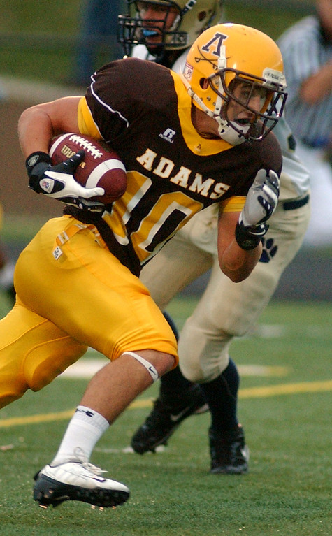 . Rochester Adams High School football player Cody Wilson breaks loose and scores his first touchdown of the day against Stoney Creek in the first quarter, Friday, September 5, 2008, in a game played at Adams HS in Rochester Hills, Mich.  (The Oakland Press/Jose Juarez)