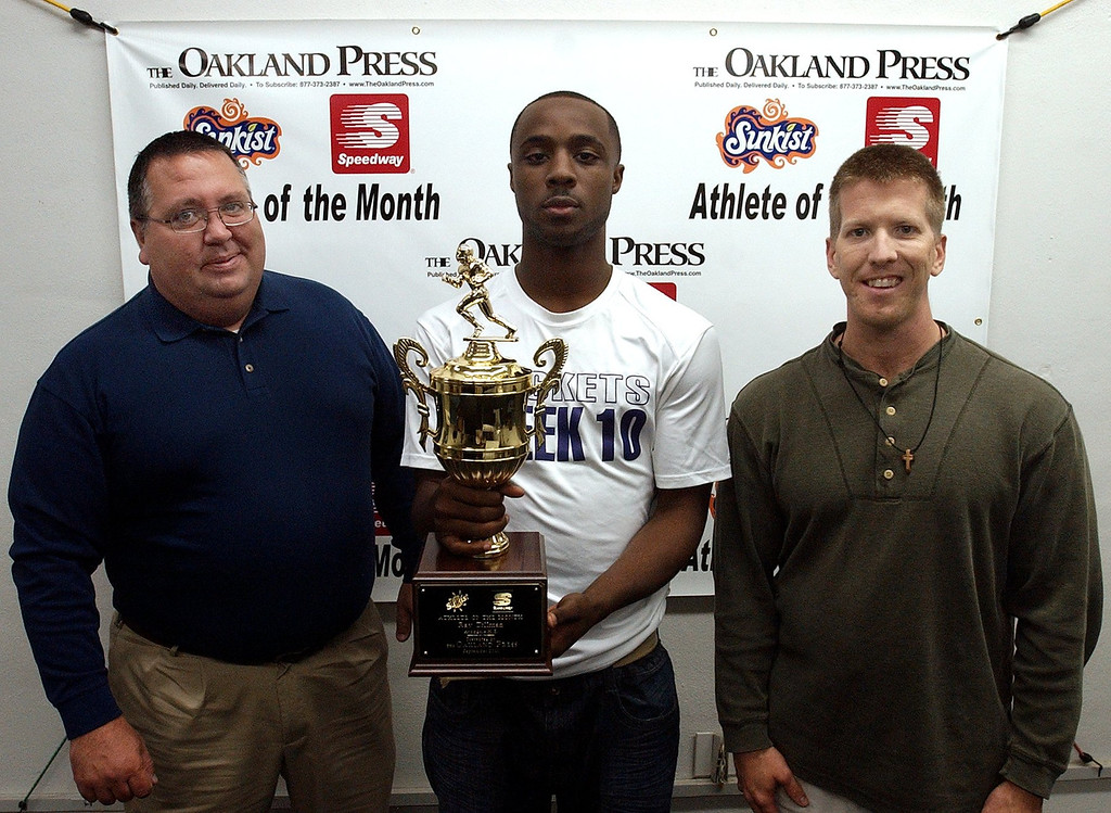 . (from left) Mark Flynn, district manager 7-Up of Detroit, Athlete of the Month  Ray Tillman, Avondale High School football player and Keith Dunlap, Oakland Press sports reporter. (Oakland Press Photo:Vaughn Gurganian)